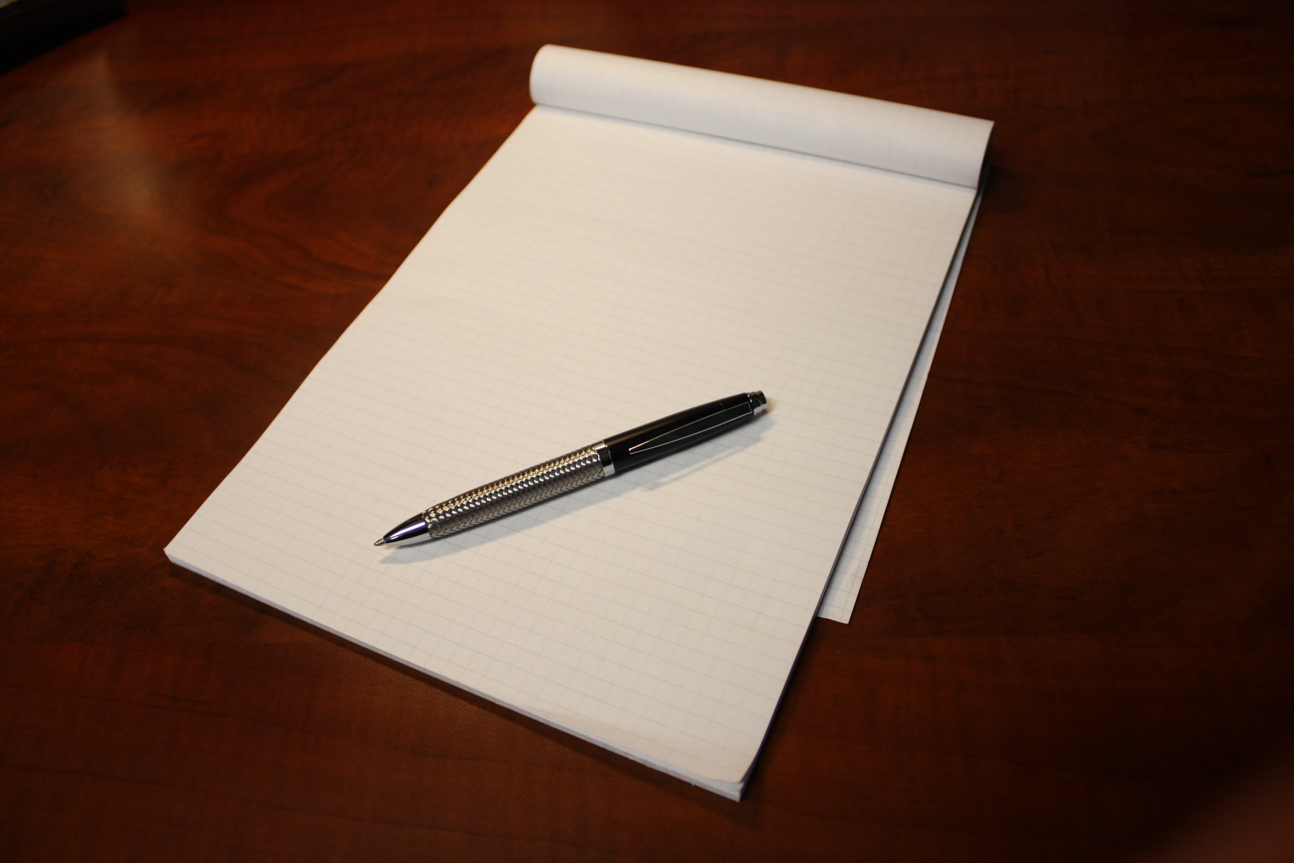 pen on legal pad