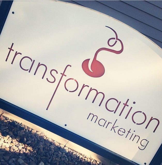 Transformation Marketing sign in front of building