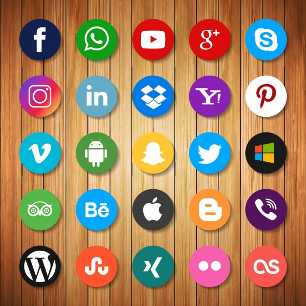 social media icons against a wood background