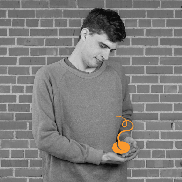 Portrait of Evan holding TM Bean logo