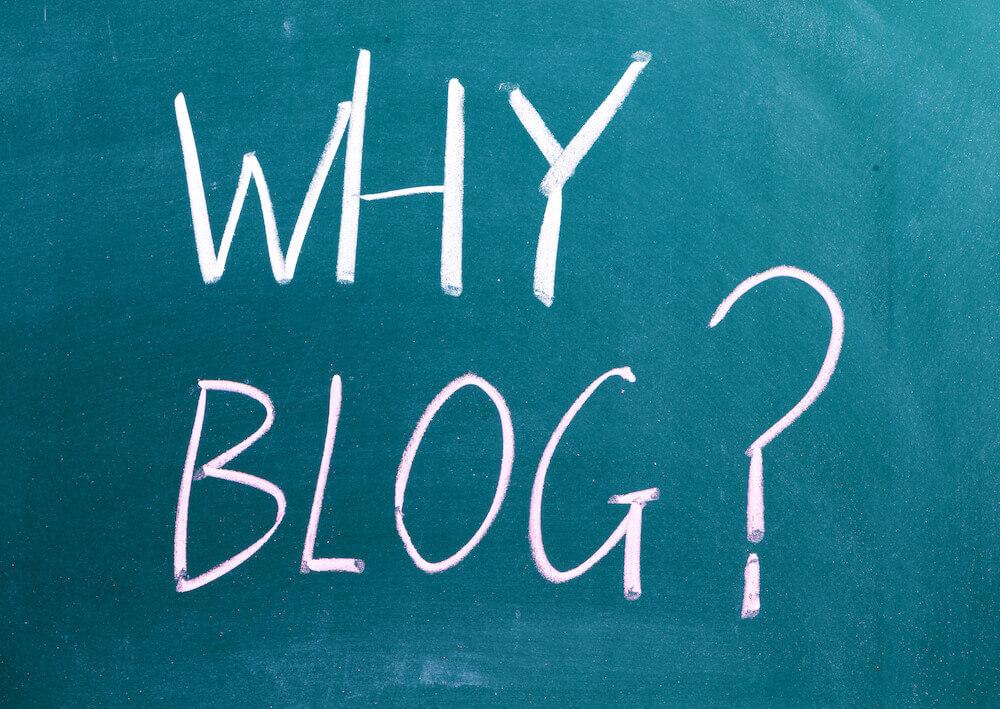 """Why Blog"" written on chalk board"