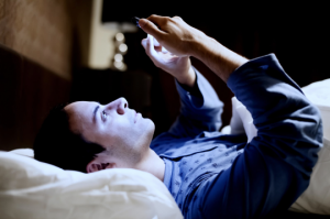 Checking phone in bed