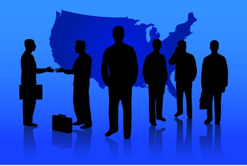 Business leaders silhouetted in front of map of the united states