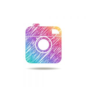 vintage camera painted colors of the rainbow. instagram logo